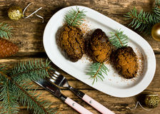 Xmas dessert in a pinecone form Royalty Free Stock Image