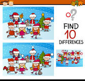 Xmas differences task for kids. Cartoon Illustration of Differences Educational Task for Preschool Children with Kids Characters on Christmas Time Royalty Free Stock Photo