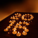 Xmas evening tea light candles in form of 2016 new year Stock Photography