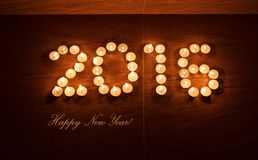 Xmas evening tea light candles in form of 2016 new year Stock Photo