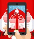 Xmas-foto Santa Claus som ger gåvan Jul som fotograferar sma Royaltyfri Foto