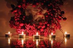 Xmas garland. Photo of christmas garland and candles Royalty Free Stock Image