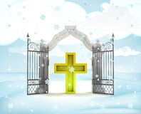 Xmas gate entrance with golden cross in winter snowfall Royalty Free Stock Photo