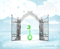 Xmas gate entrance with green key in winter snowfall Stock Photography