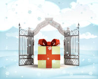Xmas gate entrance with heavenly gift in winter snowfall Royalty Free Stock Photos