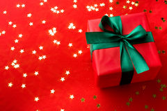 Xmas gift over golden stars. Close-up xmas gift over golden stars background Royalty Free Stock Image