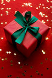 Xmas gift over golden stars Royalty Free Stock Photos