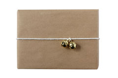 Xmas gift in simple modern gift wrap with two golden bells Stock Photos