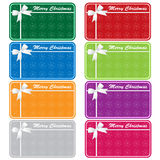 Xmas gift tags assorted colors. Christmas gift tags in 8 assorted colors with bows and snowflakes. Copy space for text. Isolated on white royalty free illustration