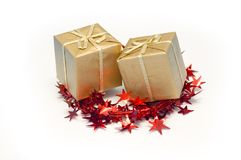 Xmas gifts. Golden xmas gifts in red stars Royalty Free Stock Image