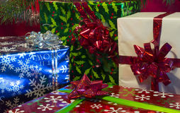 Xmas gifts. Colored christmas gifts sit under tree stock photo