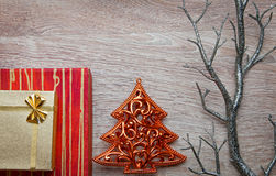 Xmas gifts with pine tree on wood Royalty Free Stock Photography