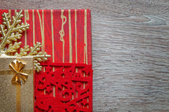 Xmas gifts on wood background Royalty Free Stock Image