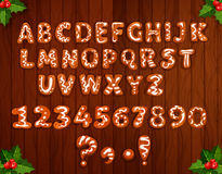 Xmas gingerbread alphabet on wooden background Stock Image