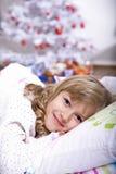 Xmas girl in bed Stock Photos