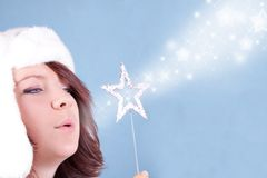 Xmas girl blowing stars Royalty Free Stock Images