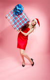Xmas girl with gift Royalty Free Stock Photo