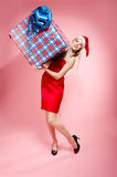 Xmas girl with gift Royalty Free Stock Images