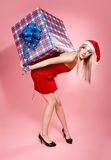 Xmas girl with gift Stock Photos