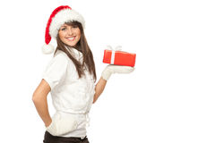 Xmas girl with girt. Side view of a girl in Santa hat holding a Xmas gift on her palm, isolated on white background royalty free stock photography