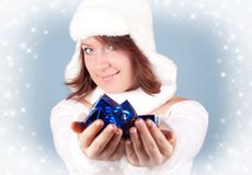 Xmas girl giving a present Royalty Free Stock Image