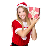 Xmas girl guess the thing in giftbox Stock Image