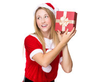 Xmas girl guess the thing in giftbox Royalty Free Stock Photography