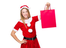 Xmas girl hold with shopping bag Stock Photo