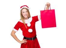 Xmas girl hold with shopping bag. On white background Stock Photo