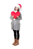Xmas girl holding love shape pillow Royalty Free Stock Photo