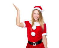 Xmas girl with open hand palm Stock Image