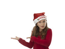Xmas girl pointing to object Royalty Free Stock Photo