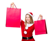 Xmas girl raise up with paper bag Stock Image