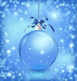 Xmas glass blue ball with snow inside and bow. Stock Image