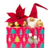 Christmas dwarf with poinsettia Royalty Free Stock Photos