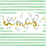 Xmas Gold and silver and star glittering elegant modern brush lettering design on a green striped background vector.  Stock Photos