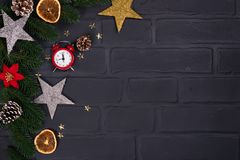 Xmas greeting card. Christmas background with toys and alarm clock. View from above with space for your greetings royalty free stock photo