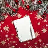 Xmas greeting card, notebook, for Santa`s letter. Fir branches with Christmas balls. Top view. Snow effect.  royalty free stock image