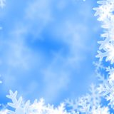 Xmas greeting card. Snow flakes on a soft blue background Royalty Free Illustration