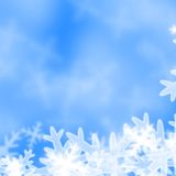 Xmas greeting card. Snow flakes on a soft blue background Vector Illustration