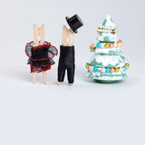 Xmas greeting card template. Clothespin couple. Abstract old fashioned gentleman and woman, christmas fur tree with Royalty Free Stock Image