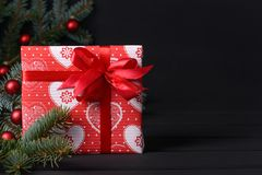 Xmas greeting card. Christmas background with gift box and fir tree Royalty Free Stock Photos