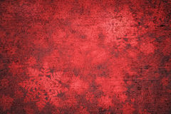 Xmas grunge red abstract textured snowflakes background Stock Photo