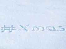 #Xmas hash tag written on blue snow, christmas hashtag lettering Stock Photography