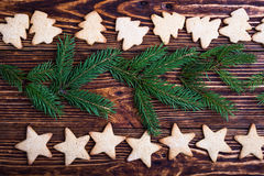 Xmas holiday background with cookies and spruce twigs Stock Image