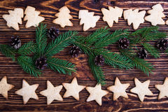 Xmas holiday background with cookies and spruce twigs Royalty Free Stock Image