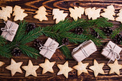 Xmas holiday background with cookies, spruce twigs and gift boxe Royalty Free Stock Image