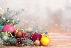Xmas holiday background. Fir& balls on wood with blurred backdro Stock Photos