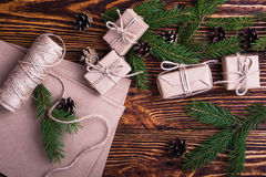 Xmas holiday background with spruce twigs and gift boxes Royalty Free Stock Photo