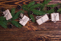 Xmas holiday background with spruce twigs and gift boxes Stock Images
